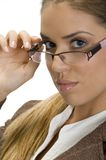 Pretty woman posing with her eyewear Stock Images