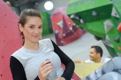 Pretty woman posing at indoor climbing wall royalty free stock images