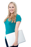 Pretty woman posing with laptop Royalty Free Stock Photos
