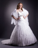 Pretty woman posing in luxurious wedding dress Royalty Free Stock Photo