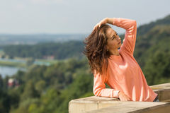 Pretty woman posing for the photographer outdoors. Travel. Royalty Free Stock Photography