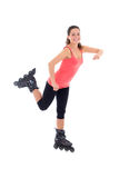Pretty woman posing on roller skates isolated on white Royalty Free Stock Image