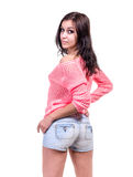 Pretty woman posing in sexy jeans shorts.  Isolated on white Royalty Free Stock Images