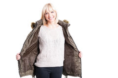 Pretty woman posing wearing warm sweater and jacket Royalty Free Stock Photos