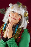 Pretty woman praying for Christmas royalty free stock images