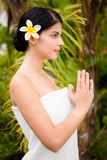 Pretty woman praying before her spa day Royalty Free Stock Photos