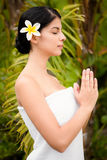 Pretty woman praying before her spa day Royalty Free Stock Photo