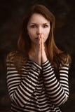Pretty woman praying Royalty Free Stock Images