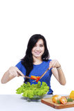 Pretty woman prepare salad 1 Royalty Free Stock Image