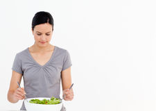 Pretty woman preparing a salad in the kitchen Royalty Free Stock Image