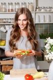 Pretty woman preparing sandwich Royalty Free Stock Photography