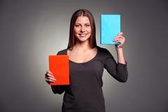 Pretty woman presentation books Stock Photography