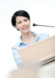 Pretty woman presenter at the podium Stock Image