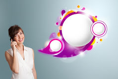 Pretty woman presenting abstract speech bubble copy space and ma Royalty Free Stock Photos
