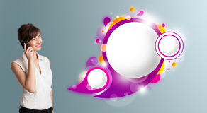 Pretty woman presenting abstract speech bubble copy space and ma Stock Photography