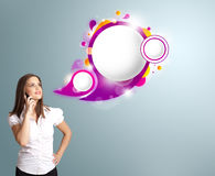 Pretty woman presenting abstract speech bubble copy space and ma. Pretty young woman presenting abstract speech bubble copy space and making phone call Royalty Free Stock Images