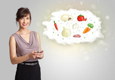 Pretty woman presenting a cloud of healthy nutritional vegetable Stock Images