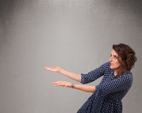 Pretty woman presenting an empty copy space Royalty Free Stock Photo
