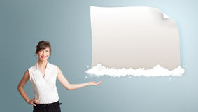 Pretty woman presenting modern copy space on clouds Royalty Free Stock Photos