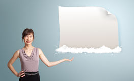 Pretty woman presenting modern copy space on clouds Stock Photo