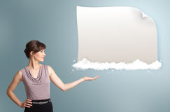 Pretty woman presenting modern copy space on clouds Royalty Free Stock Photography