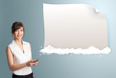 Pretty woman presenting modern copy space on clouds Stock Photos