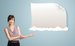 Pretty woman presenting modern copy space on clouds Stock Photography