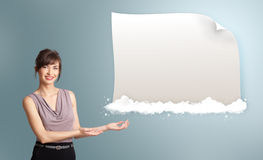 Pretty woman presenting modern copy space on clouds Stock Images