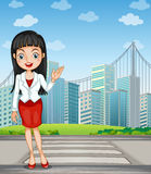 A pretty woman presenting the tall buildings Royalty Free Stock Photography
