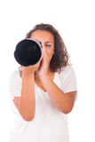 Pretty woman is a professional photographer with camera lens Royalty Free Stock Photo