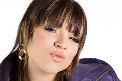Pretty woman puckering lips into a kiss Stock Photos