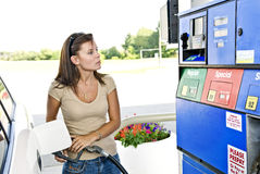Pretty Woman Pumping Gas Royalty Free Stock Photography