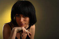 Pretty woman put head on hand Royalty Free Stock Image