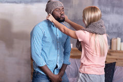 Pretty woman putting hat on her boyfriend Royalty Free Stock Images