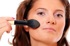 Pretty woman putting on make up Stock Photography