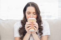 Pretty woman in pyjamas having coffee Stock Image