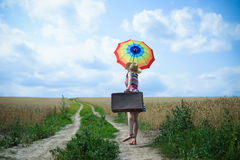 Pretty woman with rainbow umbrella and old Stock Photography