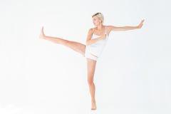 Pretty woman raising her leg Stock Photo