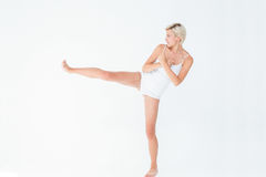 Pretty woman raising her leg Royalty Free Stock Images