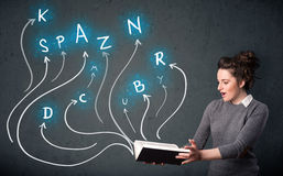 Pretty woman reading a book while multiple choices are coming ou Stock Images