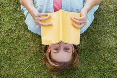 Pretty woman reading book in park Stock Photo