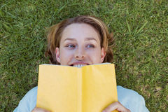 Pretty woman reading book in park Stock Images