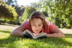 Pretty woman reading book in park Royalty Free Stock Images