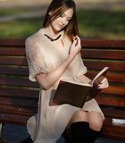 Pretty woman  reading book Stock Images