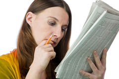 Pretty woman reading the classified ads Royalty Free Stock Images