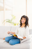 Pretty woman reading on couch Royalty Free Stock Image