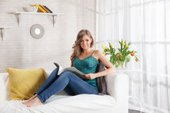 Pretty woman reading a magazine Royalty Free Stock Image
