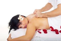 Pretty woman receive deep back massage stock photography