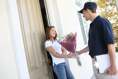 Pretty Woman Receiving Flowers Royalty Free Stock Photography