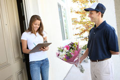 Pretty Woman Receiving Flowers Royalty Free Stock Image
